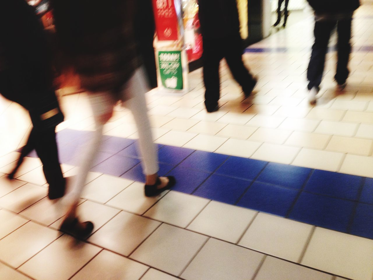 blurred motion, motion, real people, walking, speed, low section, human leg, indoors, urgency, lifestyles, tile, transportation, rush hour, commuter, subway station, day, women, pedestrian, one person, city, people, adult