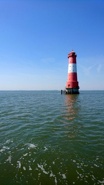 Lighthouse Arngast. Wilhelmshaven Germany Arngaster Leuchtturm Leuchtturm Arngast Leuchtturm Lighthouse Navigation Aids Navigation Maritime Ocean Sea Nordsee North Sea Red And White Blue Blue Sky Summer Horizon Deep Water Beautiful Day