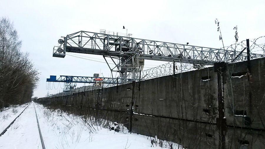 Metal bridge against sky