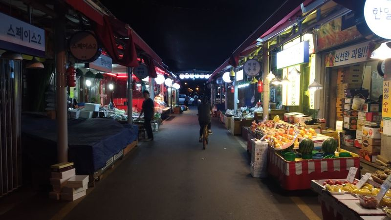 closing market Darkness And Light Streetview People And Places Korean Traditional Market Night People Bycicle Rider Freshness Lifestyles Food Market Stall Fruits Fruit Store Various Styles Live For The Story