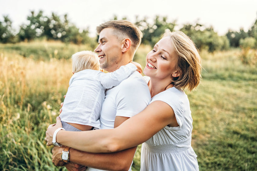 Happy family have fun outdoor Family Mother Father Childhood Son Family Love  Family Values Family Time Outdoors Plant Nature Having Fun Playing Togetherness REAL EMOTIONS Positive Emotion Candid Photography Lifestyles Smiling Happiness