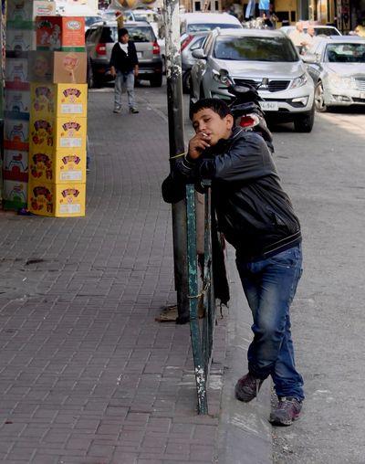 Full length of man on city street