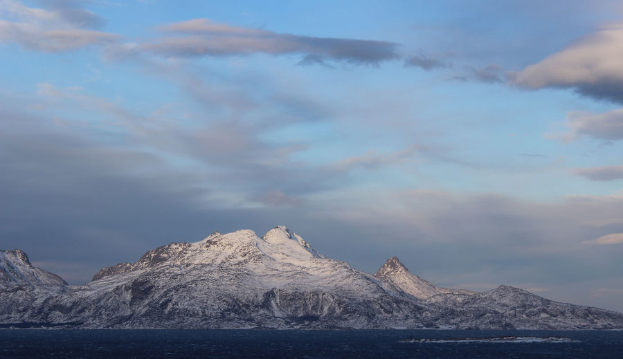 Sea and mountain in Bodø Mountain Cloud - Sky Sky Beauty In Nature Scenics - Nature Water Tranquil Scene Tranquility Mountain Range Non-urban Scene Cold Temperature No People Idyllic Waterfront Nature Snow Winter Environment Snowcapped Mountain Mountain Peak Formation Bodø Norway🇳🇴 Wintertime