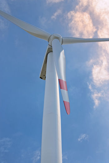 Wind turbine against blue sky with dramatic clouds Dramatic Sky Energy Hill Georgswerder Energieberg Georgswerder Low Angle View Nature Wind Turbine Wind Power Alternative Energy Blue Cloud - Sky Day Directly Above Environment Environmental Conservation Fuel And Power Generation No People Outdoors Power Supply Renewable Energy Sky Technology Turbine White Color