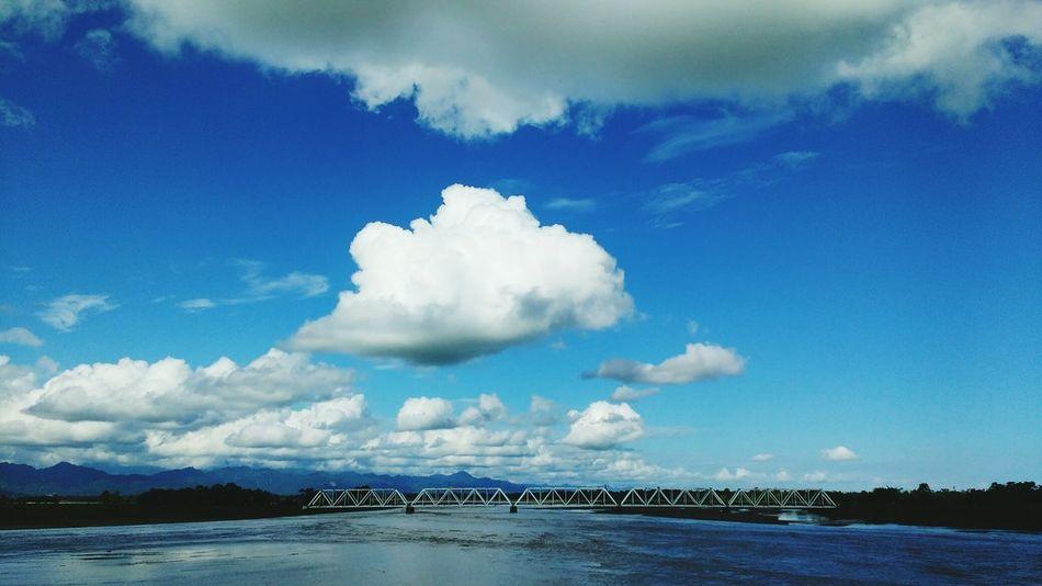 Clouds And Sky Blue And White Bridge - Man Made Structure Riverscape River Nature And Architecture Train Track Assam ArunachalPradesh India