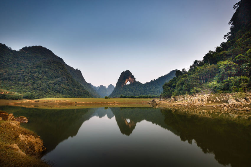 The stunning and unique view in a limestone valley in the province of Cao Bang, Vietnam Highland Mountain Adventure Agriculture Buffaloes Caobang Environment Farm Farmland Freshness Hill Hole Horizon Lake Landscape Limestone Rural Scene Sky Tourism Travel Tropical Untouched Valley Vietnam Water