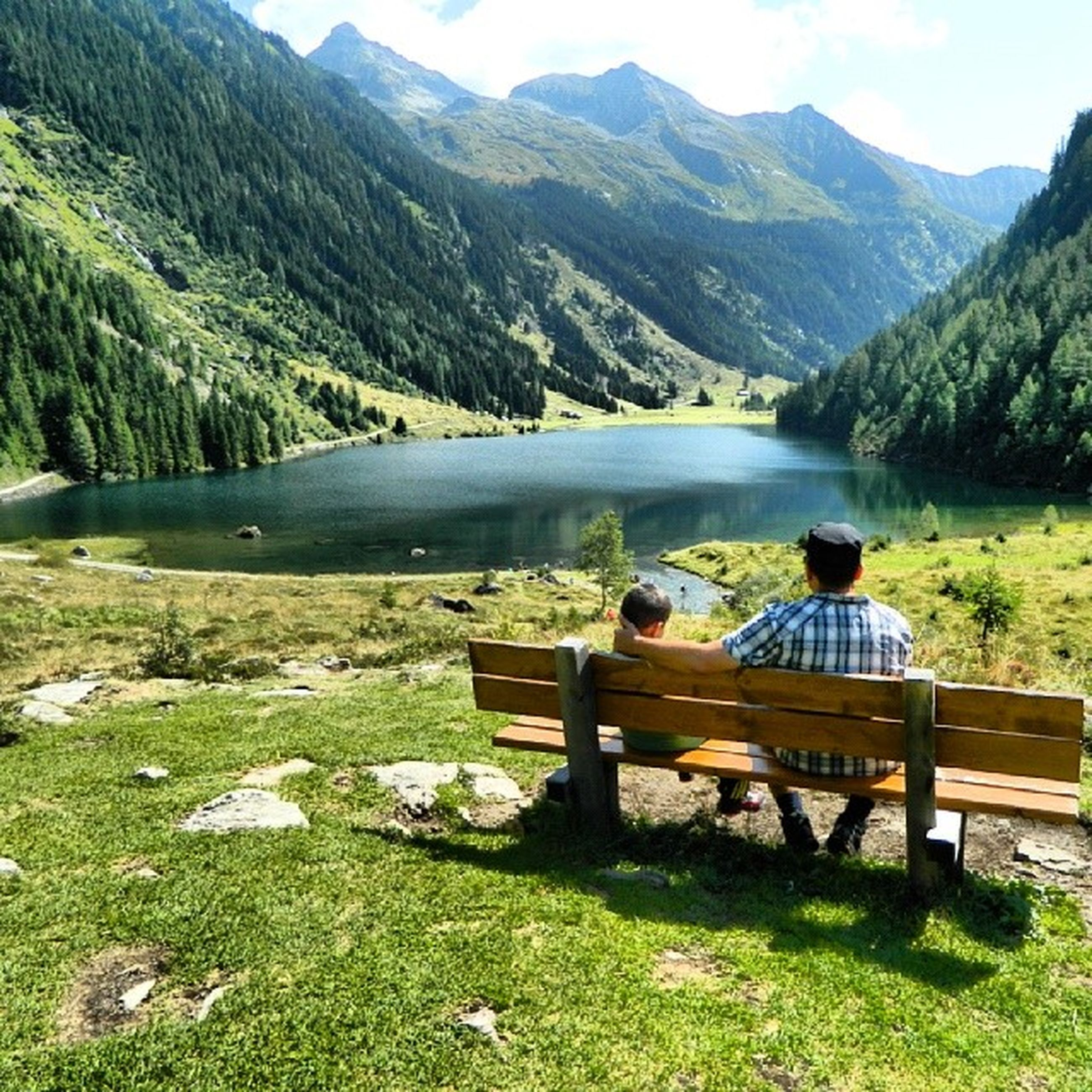 mountain, mountain range, water, tranquility, tranquil scene, lake, scenics, beauty in nature, nature, non-urban scene, idyllic, landscape, river, day, relaxation, bench, tree, outdoors, remote, sitting
