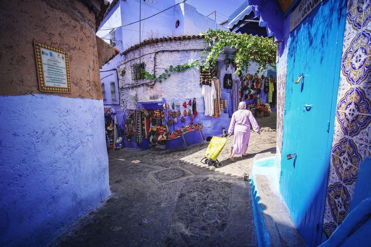 """The Blue City"" - Chefchaouen, Morocco. Chefchaouen Chefchaouen Medina Medina Morocco MoroccoTrip EyeEmNewHere a new beginning Digital Nomad Travel Travel Destinations Traveling Travel Photography Photography Blue City Alley Maze Arabic Moroccans Tourism Tourist Attraction  Tourist Destination Real People Architecture Built Structure People Day Men Full Length Building Exterior Women Building Adult Art And Craft Standing Lifestyles Two People Creativity Occupation Casual Clothing Working Outdoors"