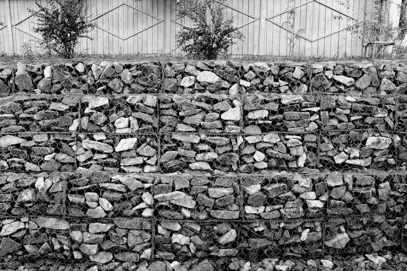 By the Stream AcroS Fujifilm Blackandwhite X100f Stonemade Craft Russia Architecture Day Built Structure No People Pattern Outdoors Textured  Backgrounds Wall - Building Feature Design Solid