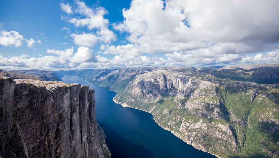 kjeragbolten Kjeragbolten Nature Norway Beauty In Nature Cliff Clouds And Sky Day Mountain Nature No People Outdoors Scenics Sky Tranquil Scene Tranquility Water