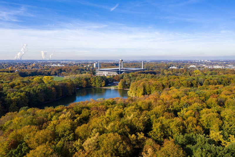 High above Stadtwald and Rhein-Energie-Stadium, Cologne in autumn Architecture Nature Day Outdoors Drone Photography Aerial Shot Leaves Tree Lakeview Autumn colors