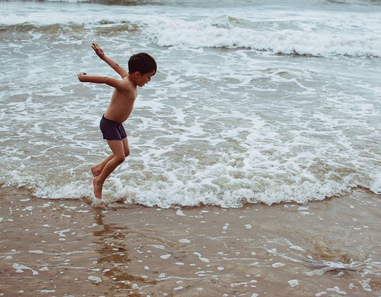 Despite the fact it was raining he was desperate to strip down in to his pants and get in the sea! He didn't mind the rain so why should I? It's good to take a childs mindset and be carefree every once in a while! Despite the rain, he still claims it was the best day of the holiday! Child Sea Shirtless One Boy Only Boys Motion Sand Wave Summer Childhood Jumping Fun Vacations Holiday Seaside Britishholidays