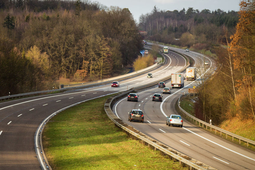 Automobile Transportation Travel Winter Autobahn Car Curve Day High Angle View Highway Land Vehicle Light And Shadow Motion Outdoors Road Speed Traffic Transportation Tree