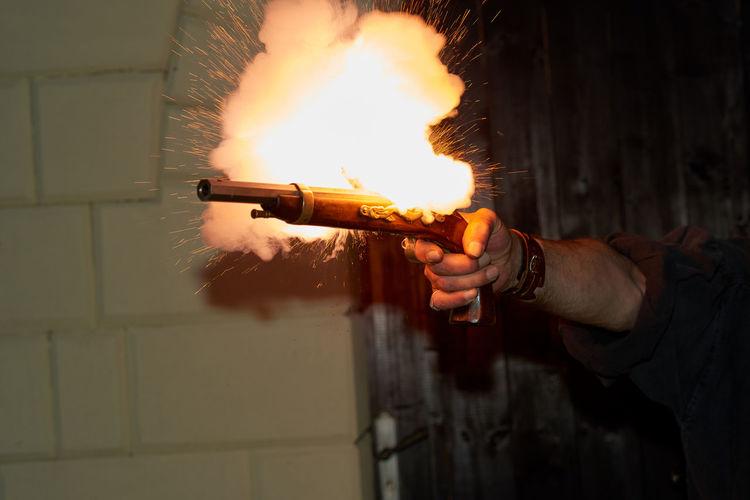 Close-up of hand shooting gun
