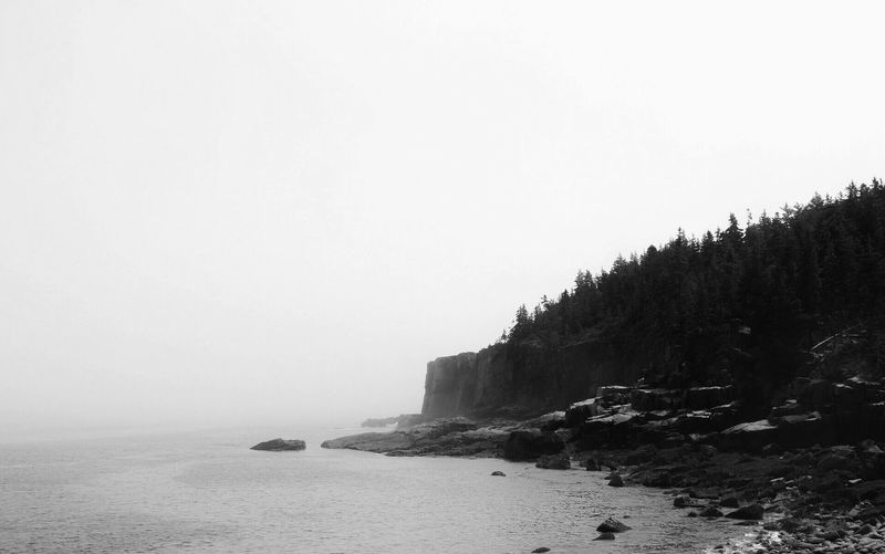 Black And White Friday Sea Nature Beauty In Nature Copy Space Clear Sky Water Scenics Tranquility Rock - Object Tranquil Scene No People Beach Outdoors Day Sand Sky Horizon Over Water