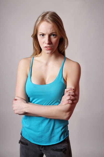 Angry Arms Crossed Casual Girl Indoor Long Hair Looking At Camera Mad Person Pissed Off  Standing Tank Top Three Quarter Length Young Adult Young Woman
