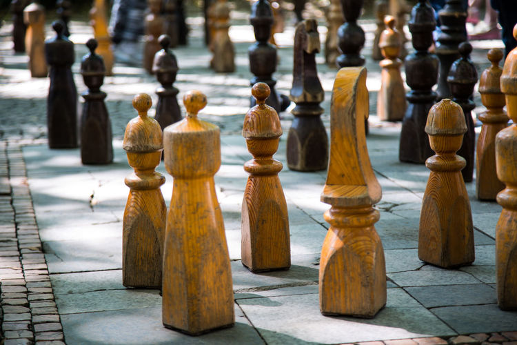 Close-up of chess pieces on footpath