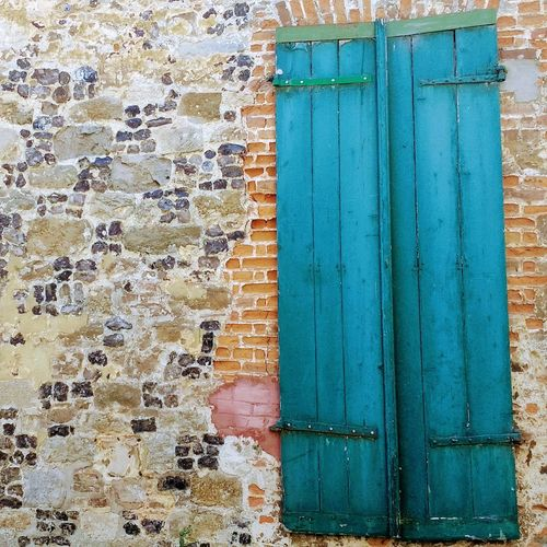 Colors in France Full Frame Multi Colored Architecture Building Exterior Outdoors Built Structure Textured  The Architect - 2017 EyeEm Awards The Street Photographer - 2017 EyeEm Awards Architecture Art Is Everywhere Colors Colour Of Life Coloured House Doors And Windows Around The World EyeEmNewHere