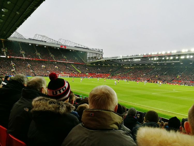 Man U fans...... Sport Stadium Spectator Sports Team Watching Soccer Crowd Competition Audience Large Group Of People People Fan - Enthusiast American Football - Sport Playing Soccer Field Competitive Sport Team Sport Adult Adults Only Only Men