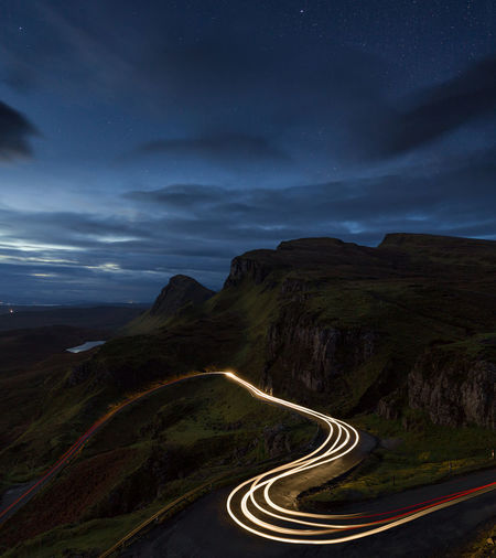High Angle View Of Light Trail On Mountain Road At Night