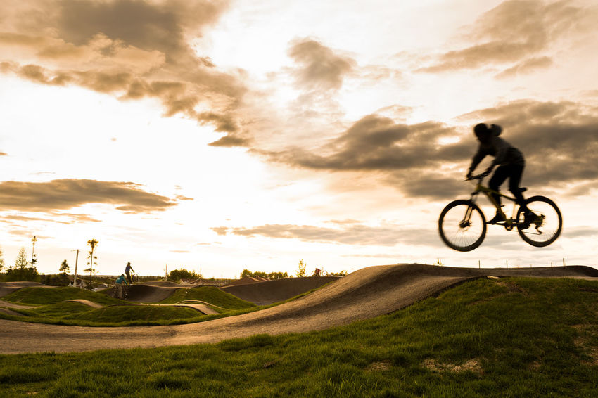 Extreme Sports - Sunset Cycle Track Excercising Adult Athlete Bicycle Bicycle Track Cloud - Sky Cycle Track Cycling Day Extreme Sports Full Length Grass Leisure Activity Lifestyles Men Motion Nature One Person Outdoors People Real People Sky Sport Sports Sportsman Sunset Track Urban