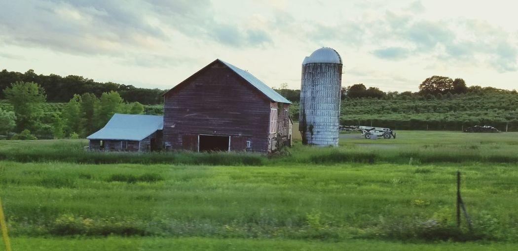 Barn on field against sky