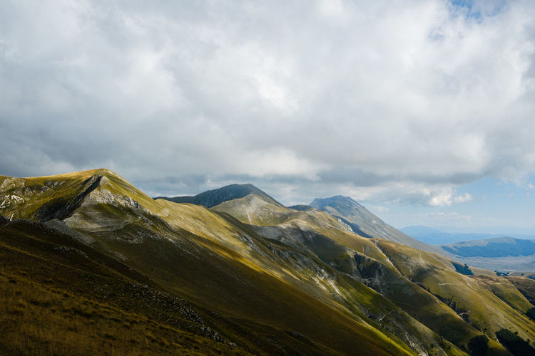 Scenic view of mountains against sky in montemonaco, marche italy