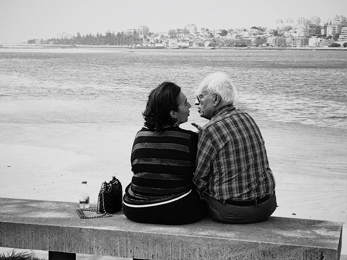 Ontheroad Streetphoto_bw Black And White Streetphotography Kiss Portugal Douro  Oporto Two People Women Togetherness Adult Rear View Nature Beach Real People Water Love Sea People Couple - Relationship
