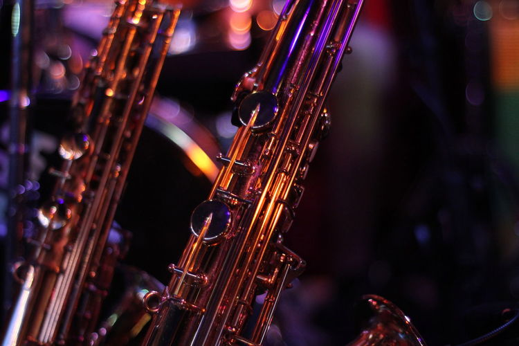 Close up saxophones on stage Stage Colorful Excitement Fun Night Life Performance Funk On Fire Matches Musical Instrument Music Saxophone Focus On Foreground Arts Culture And Entertainment Musical Equipment Close-up Indoors  Selective Focus Wind Instrument No People Brass Instrument  Metal Illuminated Still Life String Jazz Music Gold Colored Day Nightlife