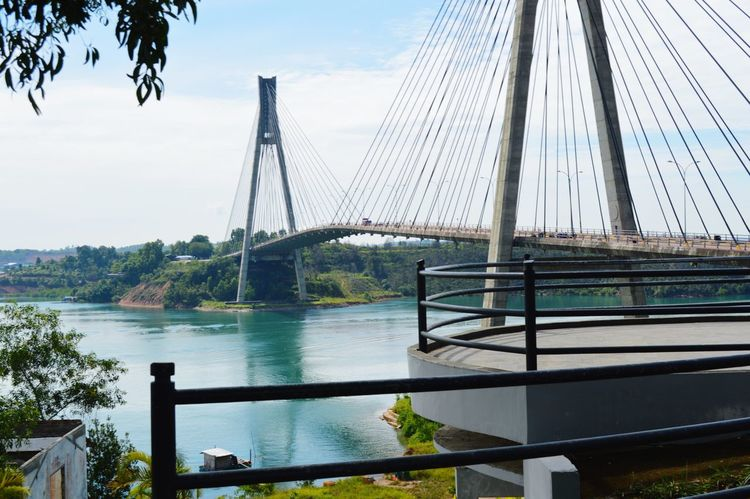 Batam bridge indonesia Bridge - Man Made Structure Sky Built Structure Connection Travel Destinations Suspension Bridge Architecture Water Tree Cloud - Sky City Outdoors Steel Sunlight Day Nautical Vessel River No People Cityscape Blue