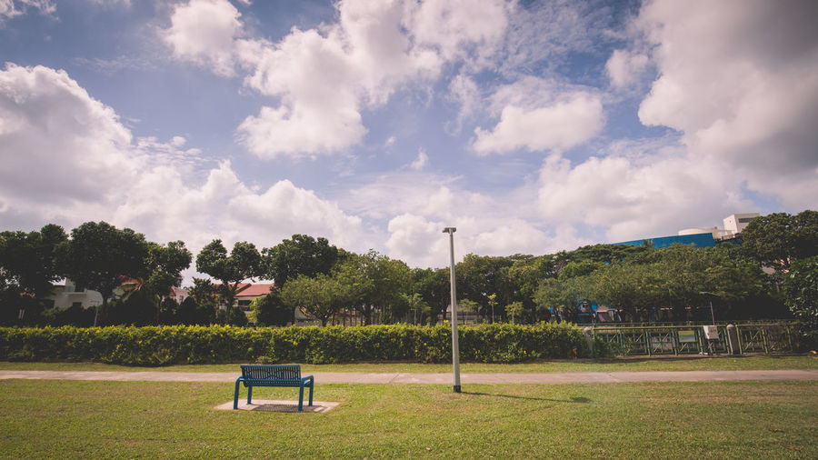 A bench, a lamp and a green view Absence Beauty In Nature Cloud - Sky Cloudy Dakota Crescent Day Empty Field Grass Grassy Green Color Growth Landscape Lawn Fine Art Photography Outdoors Park Park - Man Made Space Park Bench Scenics Sky Tranquil Scene Tranquility Tree Finding New Frontiers