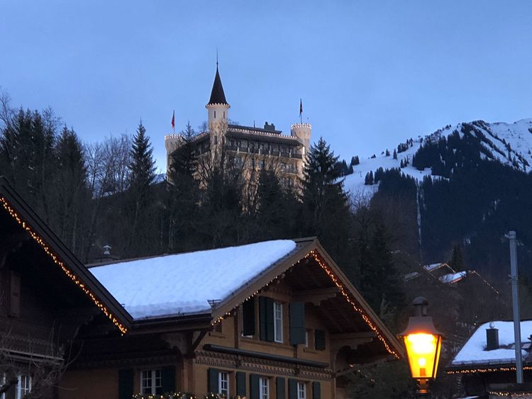 Early evening colours... GstaadPalace Top Of The Hill Bolonie Style Bolonie Art Gstaad Palace Hotel Bolonie I❤️Gstaad Architecture Building Exterior Built Structure Snow Winter Cold Temperature House Tree Illuminated Outdoors Nature Blue Sky Mountain EyeEmNewHere EyeEmNewHere Shades Of Winter