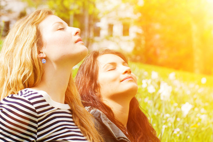 Two girls enjoying the warm sun Bronze Dreaming Females Light Nature Sunny Woman Closed Eyes Enjoy Face Girl Health Healthy Nature People Relax Relaxation Skin Spring Springtime Summer Sun Sunlight Warm Warmth