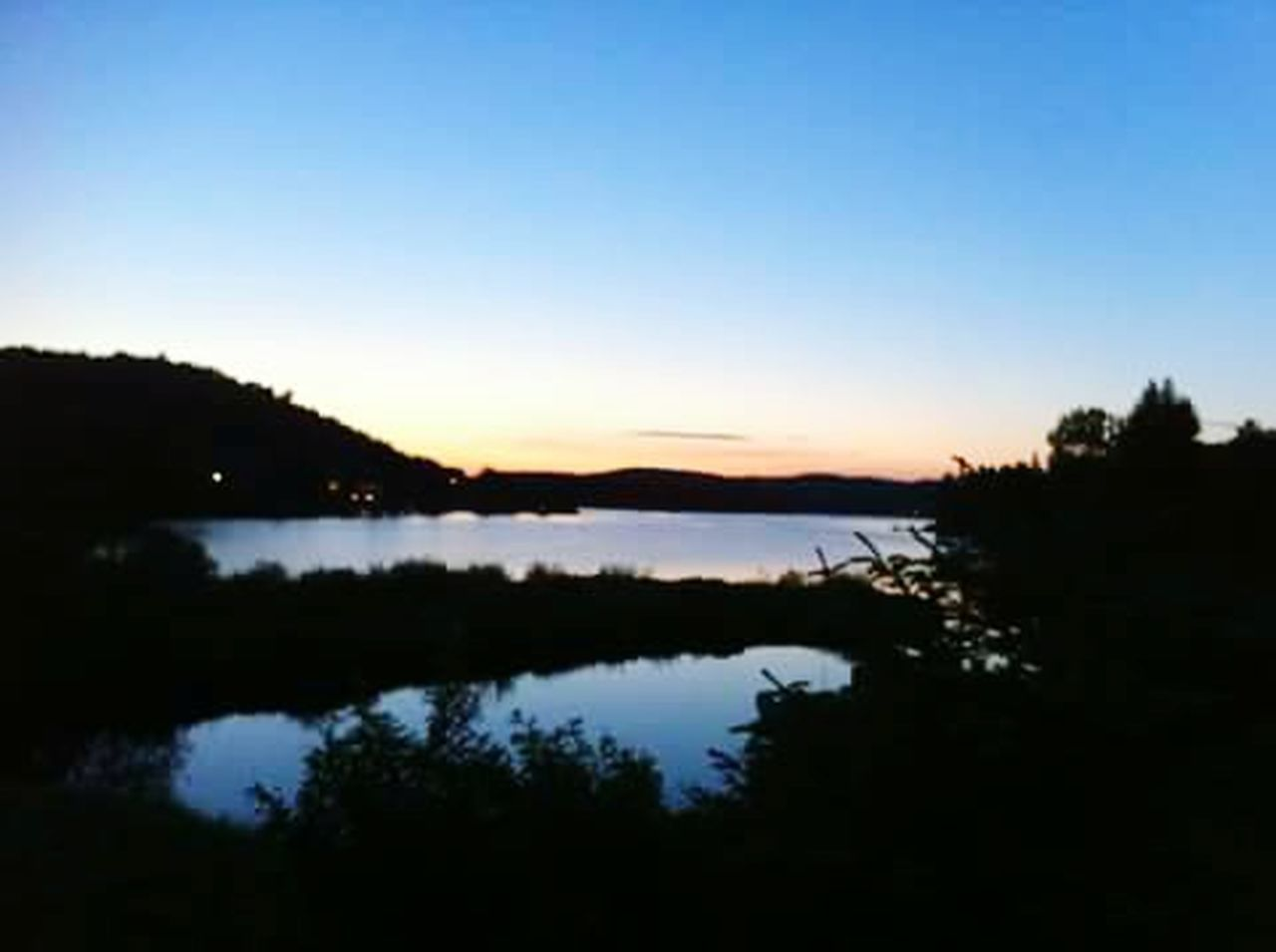 silhouette, reflection, scenics, tree, lake, nature, sunset, no people, dusk, tranquil scene, tranquility, outdoors, water, sky, beauty in nature, landscape, forest, cloud - sky, travel destinations, night, moon