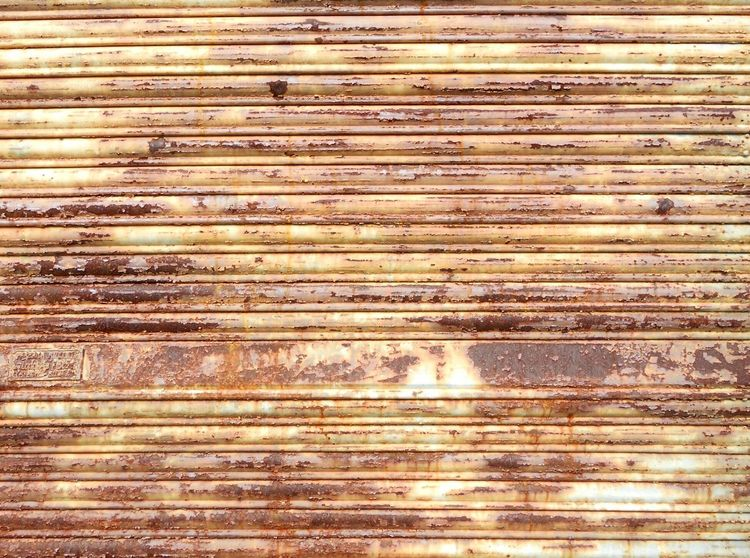 Metal Shutter Rusty Scratched Textures And Surfaces Background ArchiTexture Architectural Detail Brown Composition In Orange And Yellow