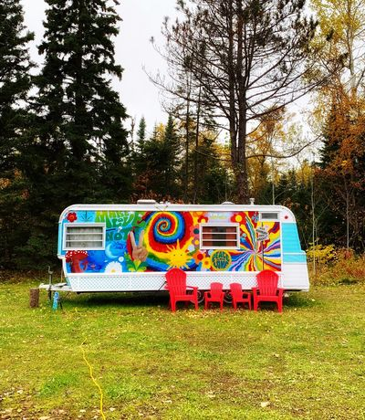 Glamping Campervan Camper Trailer Plant Tree Multi Colored Land Nature No People Field Day Outdoors Grass Sky Mode Of Transportation Transportation Creativity Graffiti