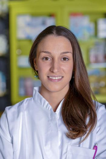 Portrait Of Smiling Female Pharmacist Standing In Store
