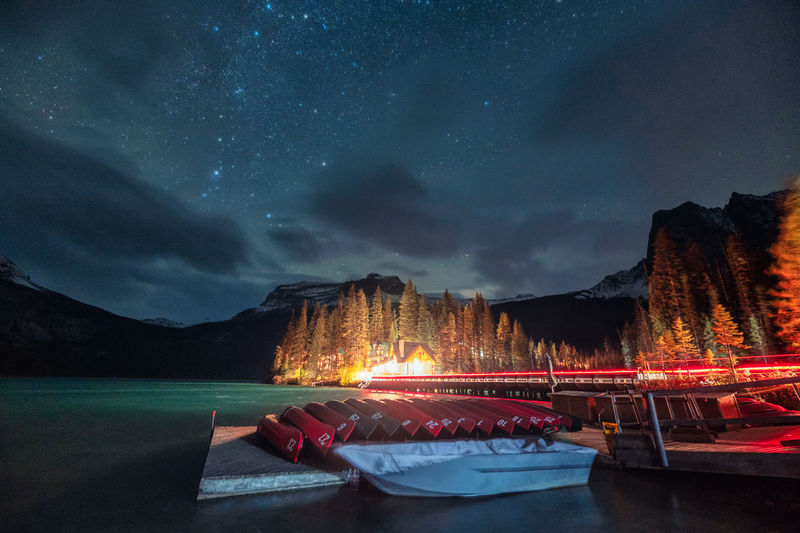 Panoramic view of illuminated mountain against sky at night