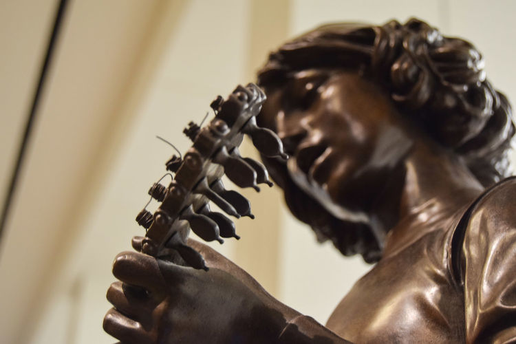 The sound of music.. Bronze Sculpture Bronze Metal Bronze Statue Playing An Instrument Strings Of Music Strings Attached Strings Banjo Player Tuning Pegs Musician Arts Culture And Entertainment Skill  Music Musical Instrument Close-up