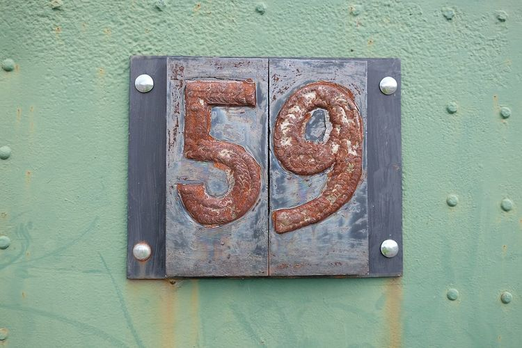 Close-up of rusty number 59