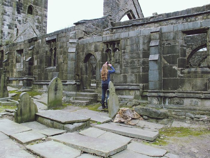 Rear View Of Woman Photographing At Heptonstall Museum