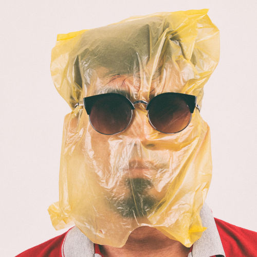 Close-Up Of Man Wearing Plastic Bag On Head