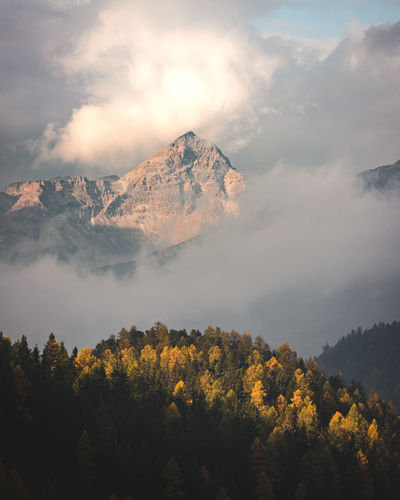 Beauty In Nature Cloud - Sky Mountain Scenics - Nature Sky Tranquil Scene Tranquility Tree Plant Nature No People Non-urban Scene Growth Idyllic Environment Landscape Land Mountain Peak Outdoors Change Snowcapped Mountain Fall Autumn Switzerland