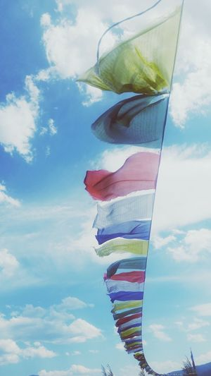 Low angle view of praying flags against sky