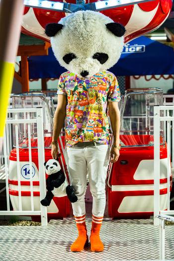 Portrait of cute boy standing at amusement park