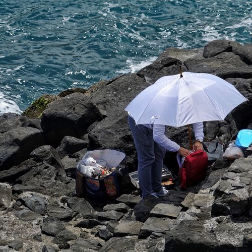 High Angle View Protection Adult Adults Only Water Only Women Umbrella One Person People Full Length Day Outdoors Real People BYOPaper!