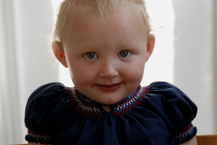 A young girl at home. Blond Hair Child Childhood Cute Indoors  Innocence Looking At Camera One Person Portrait Smiling