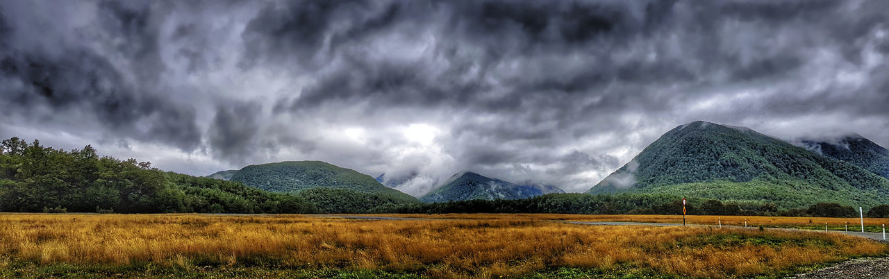 Panoramic view of landscape against storm clouds