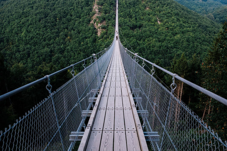 High Angle View Of Footbridge Over Mountains