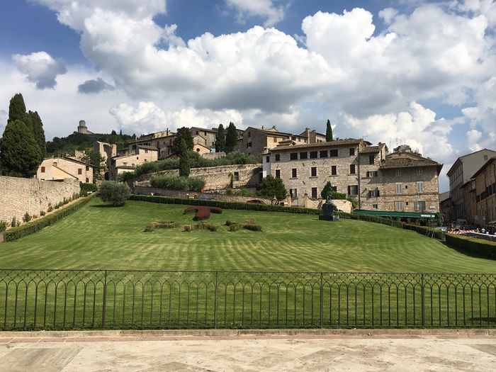 Building Exterior Architecture Grass Sky Built Structure Travel Destinations Formal Garden Outdoors Leisure Activity Green Color Day Tree Large Group Of People Cultures People Assisi Italy Frainf